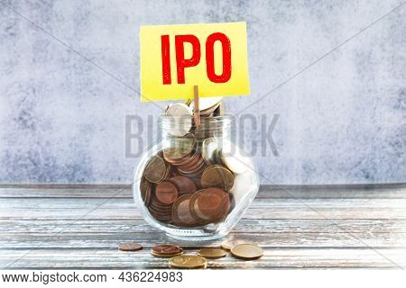 Money Bag With The Word Ipo Initial Public Offering Stock Market Launch And A Calculator. The First