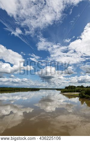 Beautiful Summer Landscape: View On Kamchatka River, Beautiful Clouds And Reflection In Water. Russi