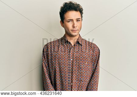 Handsome hispanic man wearing casual clothes skeptic and nervous, frowning upset because of problem. negative person.