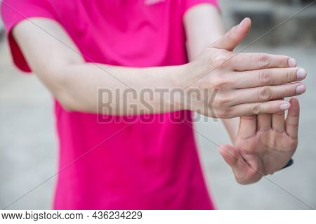 Close Up Of Woman Doing Stretching Fingers Before Workout. Wrist And Hand Exercises Can Reduce The C