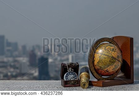 Travel Or Adventure Concept Background. Pocket Watch, Binoculars, Globe With A Sky Background. Journ