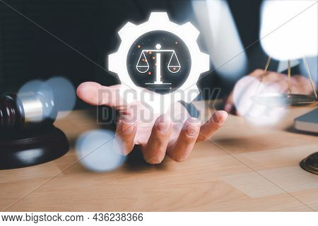 Male Lawyer Hand Holding Holographic Law Icon On Office Desk, Terrorism, Crime, Judgment, Verdict, J