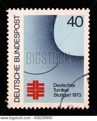 ZAGREB, CROATIA - JUNE 27, 2014: A stamp printed in Germany shows German Turner Gymnastic Festival in Stuttgart, Festival poster, circa 1973