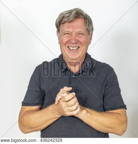 Portrait Of A Mature Man Gesturing With His Hands