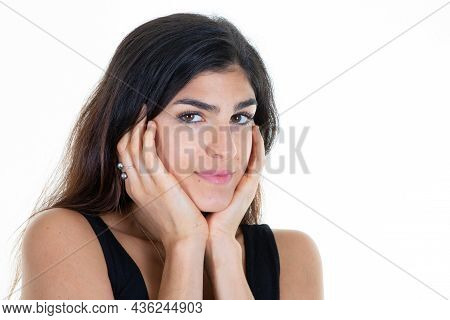 Woman Posing On Studio Shot On White Wall Hands On Chin In Fashion Pose