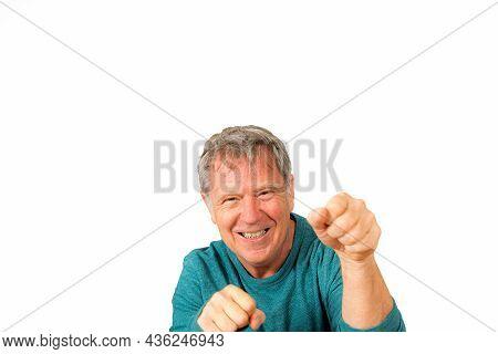 Portrait Of Handsome Smiling Senior Man Showing Fist