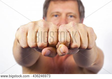 Portrait Of Attractive Looking Man Showing Fist