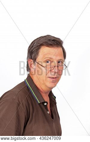 Portrait Of Attractive Looking Man With Reading Glasses