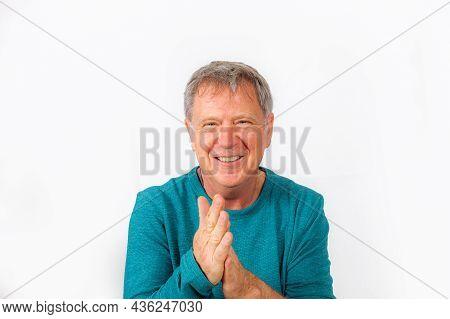 Portrait Of Handsome Smiling Caucasian Senior Man
