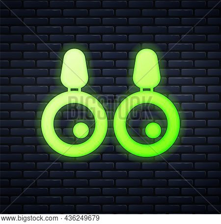 Glowing Neon Earrings Icon Isolated On Brick Wall Background. Jewelry Accessories. Vector