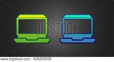 Green And Blue Laptop Icon Isolated On Black Background. Computer Notebook With Empty Screen Sign. V