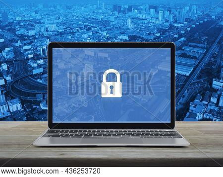 Padlock Icon On Modern Laptop Computer Monitor Screen On Wooden Table Over City Tower, Street, Expre