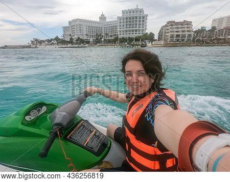 Woman Making Selfie Photo While Riding Jet Ski On Caribbean Sea Resort
