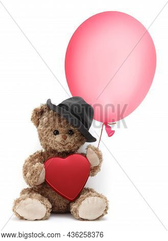 Cute Teddy Bear Wears A Hat And Holds A Balloon And A Red Heart, Isolated On White Background