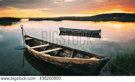 Braslaw Or Braslau, Vitebsk Voblast, Belarus. Wooden Rowing Fishing Boats In Beautiful Summer Sunset