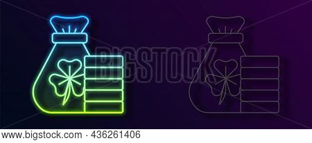 Glowing Neon Line Money Bag With Clover Trefoil Leaf Icon Isolated On Black Background. Happy Saint