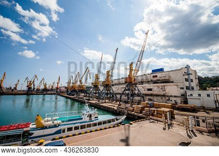 Seaport In Odessa On A Sunny Day. Cargo, Cranes, Containers, Liners. High Quality Photo