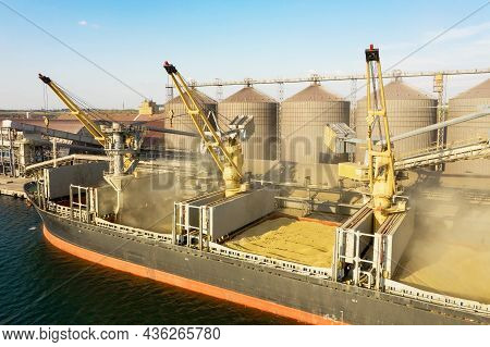 Loading Grain Into Holds Of Sea Cargo Vessel Through An Automatic Line In Seaport From Silos Of Grai
