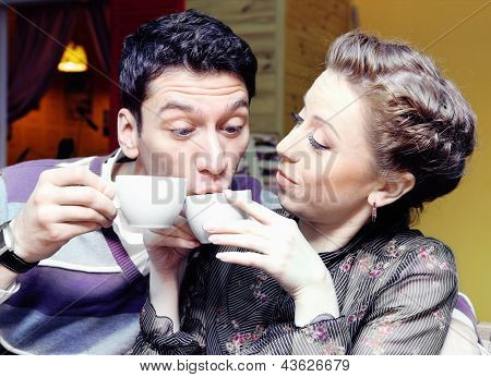 Young Lovers Drinking Coffee Funny Shot