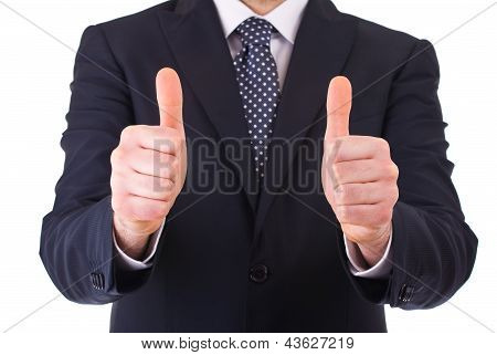 Business man showing thumbs up sign.