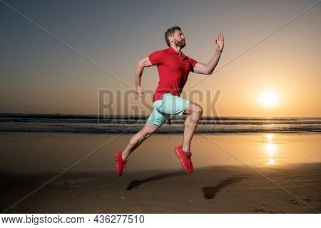 Adult Sprinter. Sport Athlete Run Fast To Win In Sea Sunset. Morning Workout Activity.
