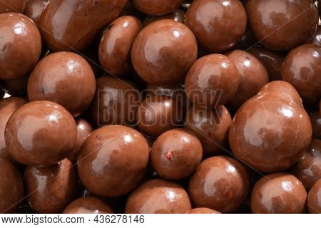Detailed And Large Close Up Shot Of Chocolate Covered Blueberries.