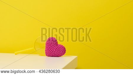 Red Heart And Magnifier On A White Table. Finding A Donor Organ