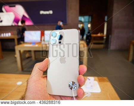 Paris, France - Sep 24, 2021: Customer Holding New Iphone 13 Pro Max With Promotion 120 Hz At The Ap