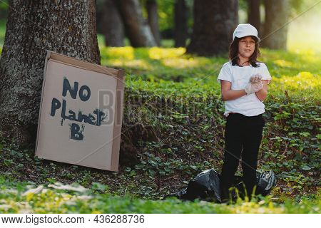 Full-length Photo Of A Happy Girl Volunteer Standing On The Ground Outdoors, Participate In Gatherin