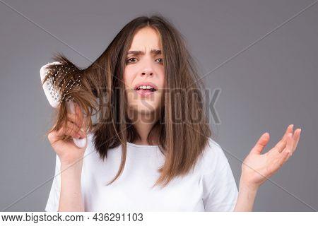 Young Woman Is Very Upset Because Of Hair Loss. Haircut And Healthy Haircare. Serious Hair Loss Prob