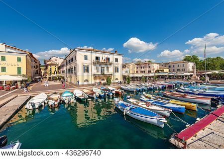 Bardolino, Italy - May 26, 2021: Small Port Of The Lake Garda (lago Di Garda) With Fishing Boats Moo