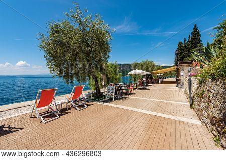 Garda, Italy - May 26, 2021: Small Bar On The Lakeshore Of Lake Garda (lago Di Garda). Garda Village