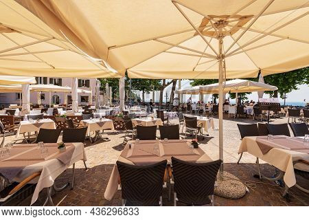 Garda, Italy - May 26, 2021: Outdoor Restaurants In The Main Square, Piazza Catullo. Small Town Of G