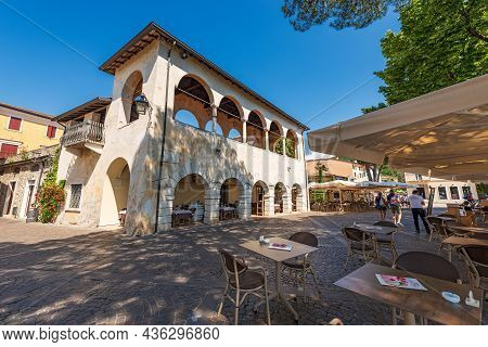 Garda, Italy - May 26, 2021: Outdoor Restaurants And Bars On The Lakefront Of The Small Town Of Gard