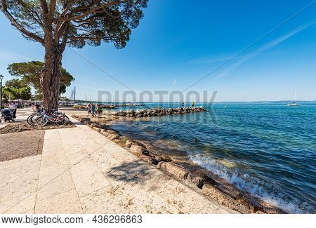 Lazise, Italy - May 26, 2021: Lakeshore Of Lake Garda (lago Di Garda) In Front Of The Small Village