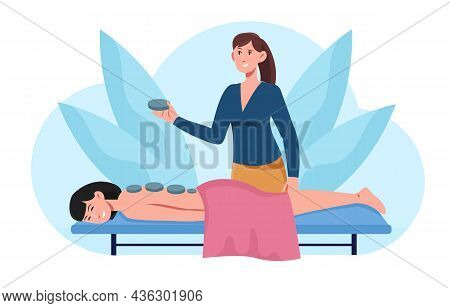 Hot Stone Massage Concept. Woman Puts Hot Stones On Patient Back. Therapy Of Pain In Spine. Client R