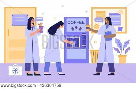 Medics On Coffee Break. Doctors And Nurses Buy Cappuccino In Special Vending Machine. Women In White