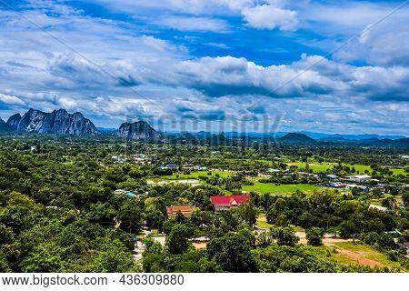 A Mountain Village In A Green Valley. Mountain Village Scene. Village In Mountain Valley. Green Vall