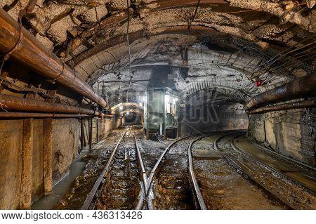 Underground Mine. Underground Railway For Transporting Ore. Mine Trolley As Part Of An Underground F