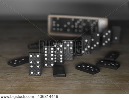 Domino Game Pieces On Wood Table With Wooden Box Case.