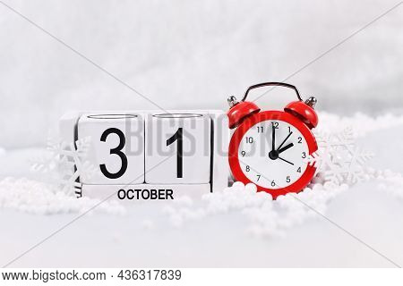 Concept For Time Change For Daylight Saving Winter Time In Europe On October 31st With Red Alarm Clo