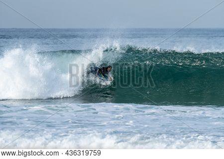 Bodyboarder Riding A Wave In S. Jacinto Beach Near Aveiro - Portugal.