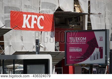Bucharest, Romania - August 11, 2021: A Kfc Fast Food Restaurant On The Ground Floor Of A Building U