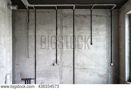 Electrical Cables And Pipes On House Concrete Wall. Modern Plastic Hoses And Conduits With Wires In