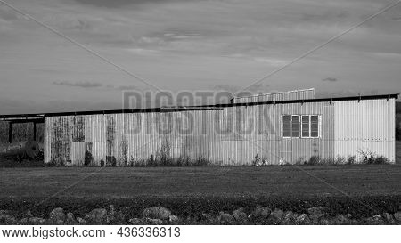 An Old Corrugated Iron Country Shed On A Rural Property In Black And White