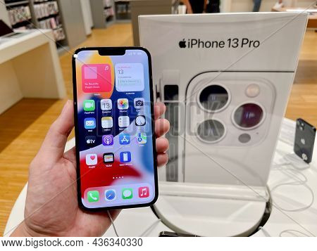 Bangkok, Thailand - October 13, 2021: Hands On Iphone 13 Series Are Shown To Sell In Istudio By Coms