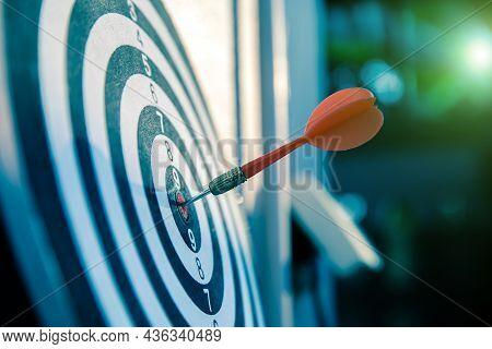 Bullseye Or Bulls Eye Target Or Dartboard Has Dart Arrow Throw Hitting The Center Of A Shooting For