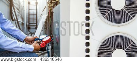 Heating And Air Conditioning, Hvac Ac System Service Technician Using Measuring Manifold Gauge Filli