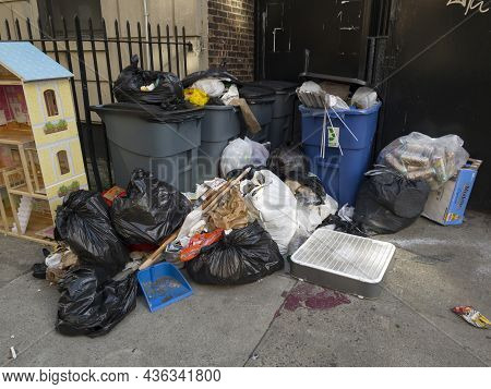 Bronx, New York, Usa - September 20, 2021: Neglected Trash Left In Front Of Apartment Building Dwell