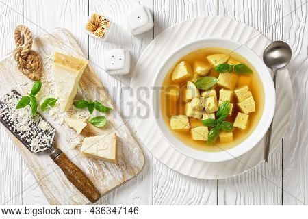 Zuppa Imperiale, Italian Soup Of Chicken Broth With Parmesan Egg Dumplings Sprinkled With Grated Che